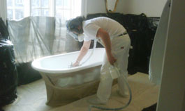 bathtub Refinisher working on a claw foot tub